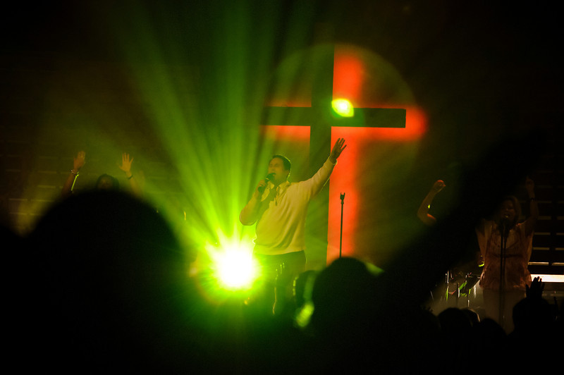 Singing with lifted hands of Praise